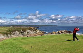 Golfing on one of the Island's coastal courses