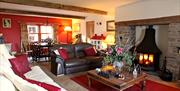 Private guest sitting room where our delicious Manx breakfast is served and you can enjoy evenings by the fire