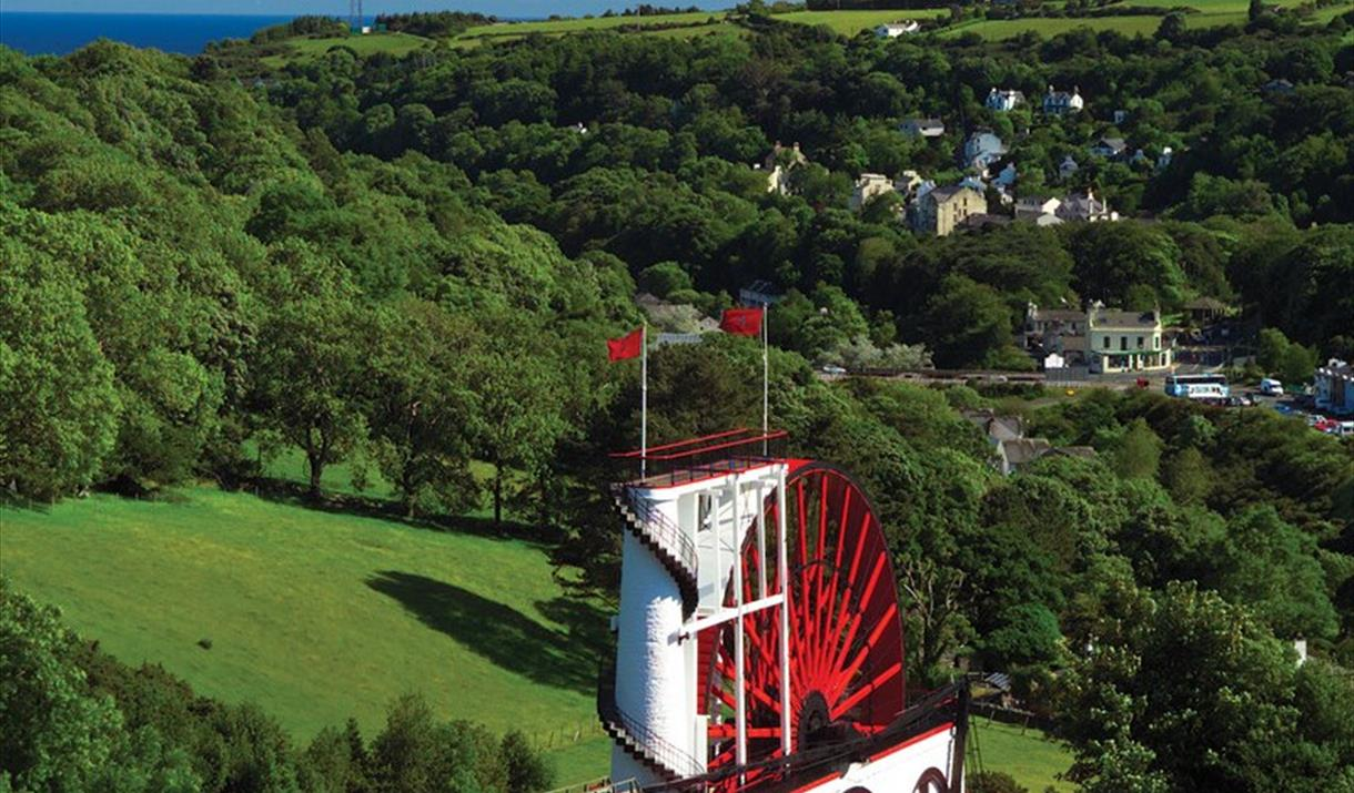 View overlooking the Great Laxey Wheel, Laxey Village and the sea