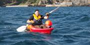 Single and double kayaks for hire on an hourly basis in Port Erin Bay