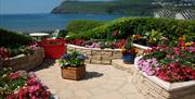 Port Erin seafront and one of the many local gardens overlooking the beach