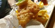 Battered Seabass fillet with chip shop style thick chips
