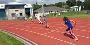 Children on the running track at the NSC Douglas