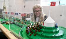 Speaker of the House of Keys inspecting the custom-built Lego model of Tynwald Day